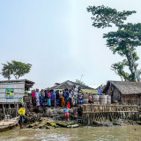 As sea levels rise, Bangladeshi islanders must decide between keeping the water out—or letting it in